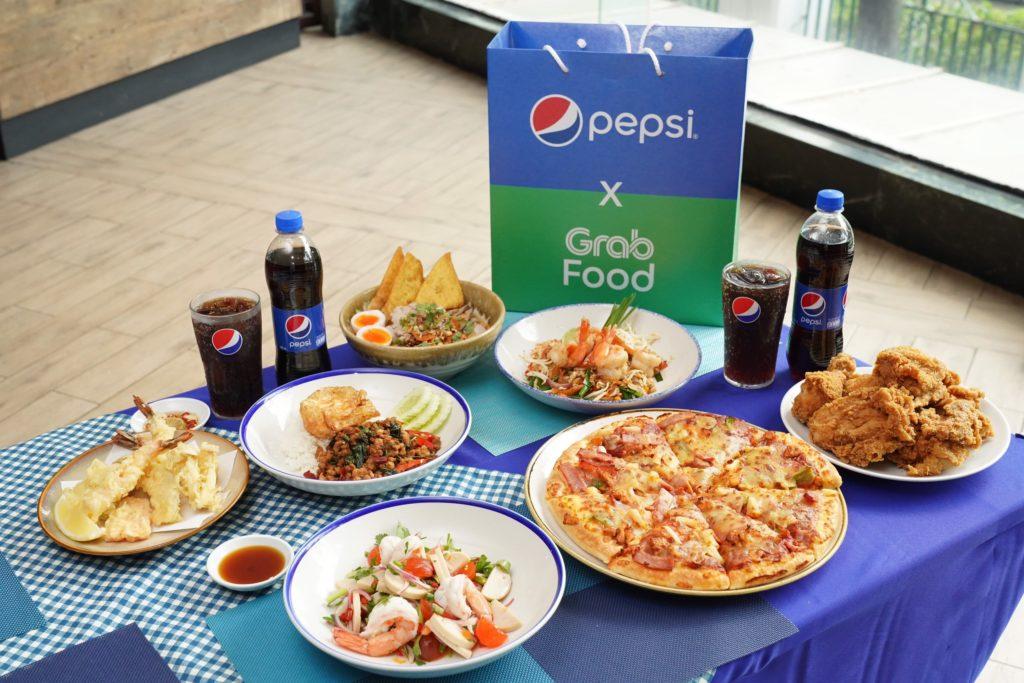 """เป๊ปซี่ และแกร็บฟู้ด จัดใหญ่เอาใจสายกิน ผ่านแคมเปญ """"GrabFood x Pepsi เพื่อนซี้จัดให้ ปี 3""""  ยกทัพความอร่อยและโปรโมชั่นเด็ดเหมือนมีเพื่อนซี้รู้ใจในทุกช่วงเวลาอาหารตลอดปี 2564"""